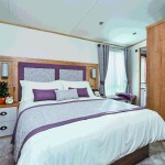 The ABI Ambleside with master bedroom with ensuite
